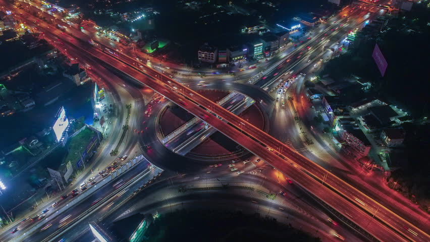 Time lapse,Hyperlapse ,Of traffic on city streets at night. Aerial view and top view of traffic on freeway, 4K. #33943537