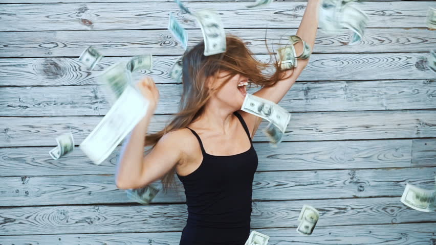 happy dancing woman with falling money. slow motion