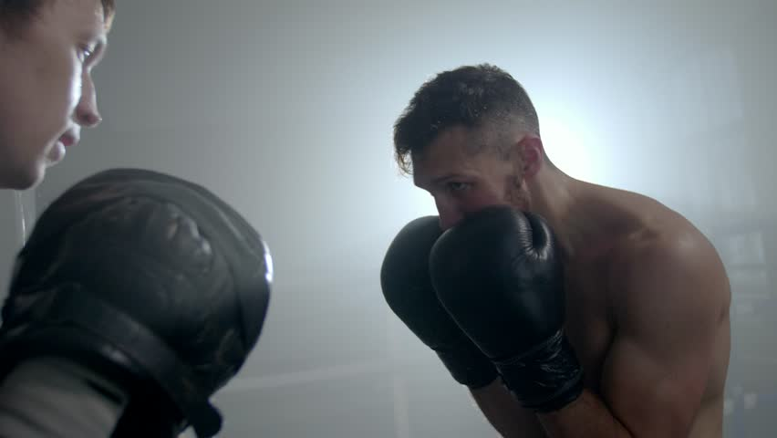 Two men training on a boxing ring