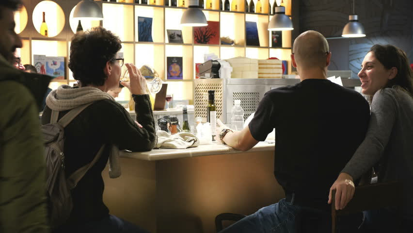 Couples Sitting At A Bar Stock Footage Video 100 Royalty Free