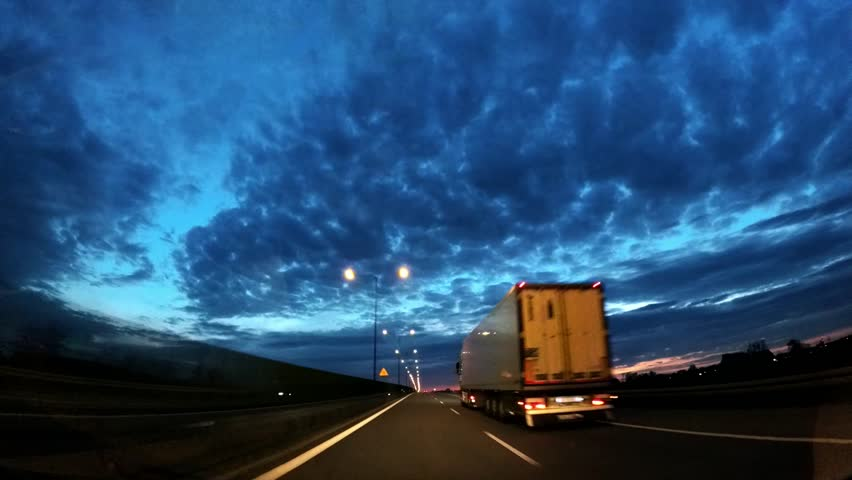Dash Cam Overtaking Truck at Sunset Blue Sky POV, Poland Europe   Shutterstock HD Video #34014817