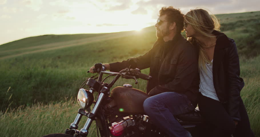 Couple on vintage motorcycle watching the sunset | Shutterstock HD Video #34134877