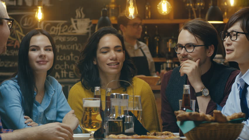 Diverse Group of Young People Have Fun in Bar, Have Conversation, Telling Stories and Jokes. They Drink Various Drinks. They're in the Stylish Hipster Restaurant.  #34161277