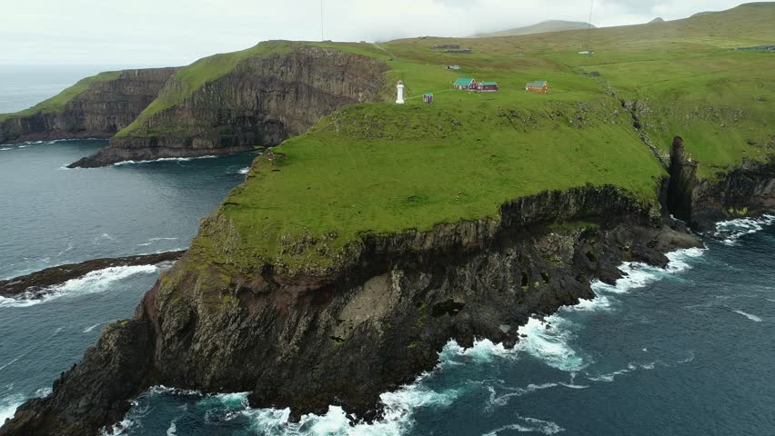 Aerial view of Akraberg Lighthouse on the island of Suduroy in the Faroe Islands, a territory of Denmark in the Atlantic Ocean