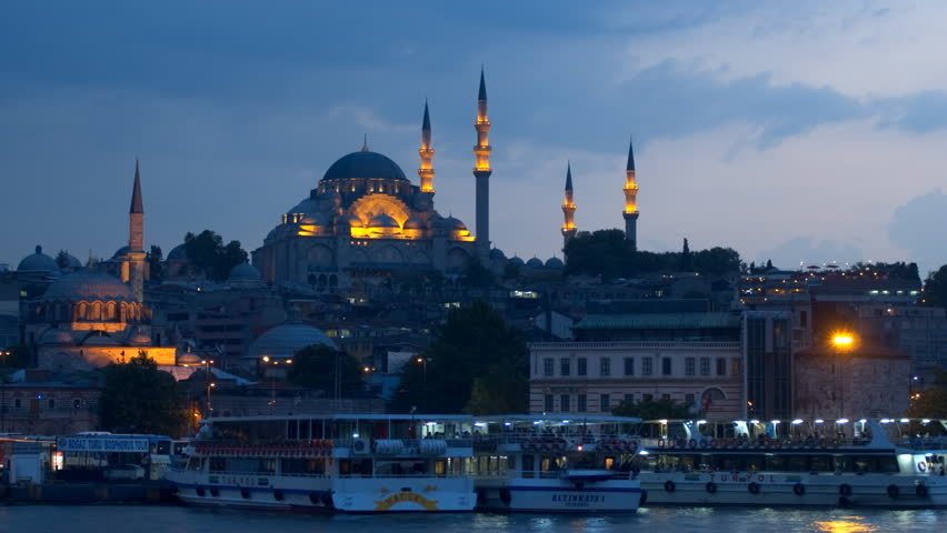 ISTANBUL, TURKEY - MAY 22: The Suleymaniye Mosque in the late evening, zoom out time-lapse. Suleymaniye Mosque is the second largest mosque in Istanbul and can accommodate more then 5,000 visitors.