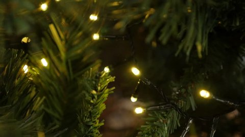 Garland with Christmas fairy-lights close-up slow-mo 1920X1080 HD footage - Slow motion sparkling decoration on the artificial tree 1080p FullHD video