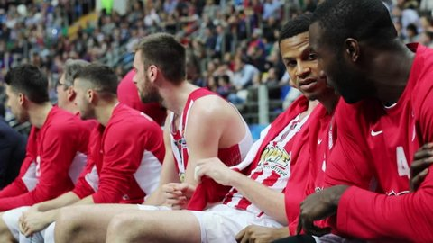 MOSCOW - APR 7, 2017: (slow motion) Players on bench at basketball game Euroleague CSKA Moscow (Russia) - Olympiakos (Greece) in Megasport stadium