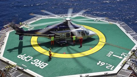 KELANTAN, MALAYSIA - NOVEMBER 16th, 2017 : A commercial helicopter Agusta Westland AW 139 ready to take off after taking offshore workers who signed off from duty at oil and gas platform.