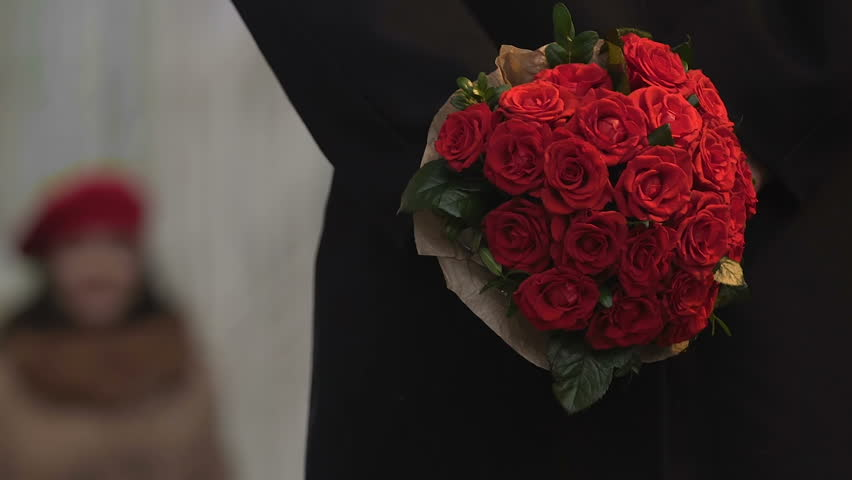 Stock Video Clip of Handsome man giving a bouquet of red | Shutterstock