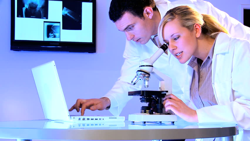 Medical students using laboratory equipment for patient healthcare