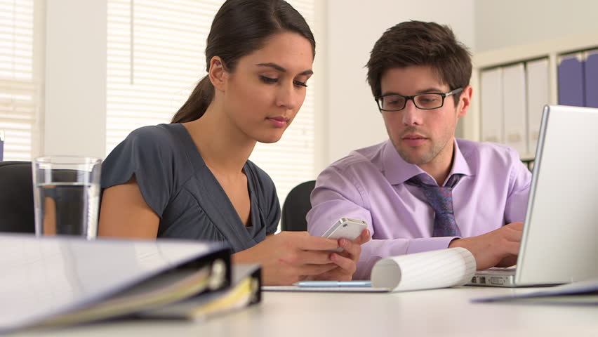 Colleagues exchanging information | Shutterstock HD Video #3440987