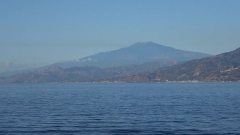 Volcano Etna at the time of the blue dawn filmed from the yacht.