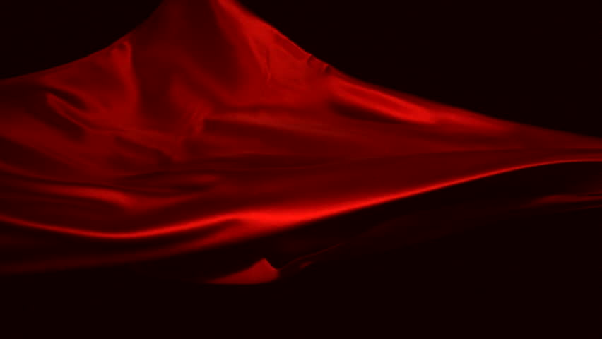 Red silk fabric flying in the air shooting with high speed camera, phantom flex.