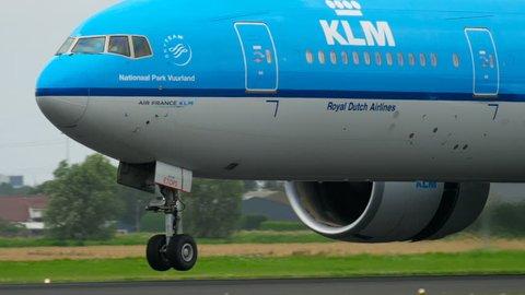 AMSTERDAM, THE NETHERLANDS - JULY 27, 2017: KLM Royal Dutch Airlines Boeing 777 PH-BVI landing on runway 18R Polderbaan, slow motion. Shiphol Airport, Amsterdam, Holland