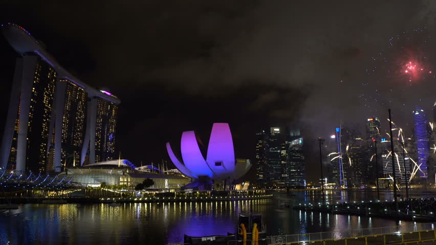 Marina Bay, Singapore - January 01, 2018: HD b-roll cinematic footage of new year eve 2018 fireworks show at Marina Bay, Singapore. Pan right #34441147