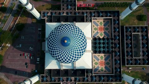 Bird eyes view aerial footage of Sultan Salahuddin Abdul Aziz Shah Mosque in Selangor, Malaysia.