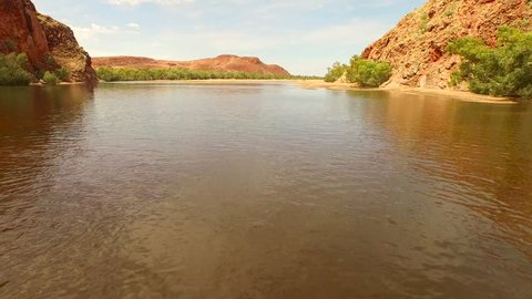 Aerial footage flying across the outback swimming hole at Doolena Gorge near the mining town of Marble Bar in the Pilbara region of Western Australia, Australia.