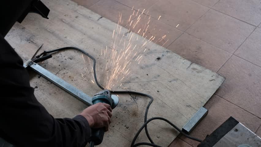 Top view of worker welding iron on wooden board   Shutterstock HD Video #34475737