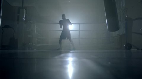 Man boxer training hard for a fight
