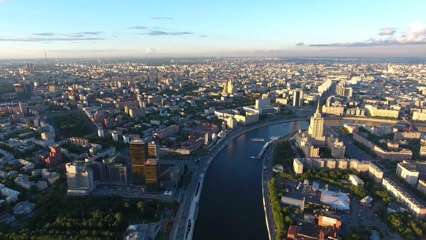 Bird's eye view of Moscow panorama with high buildings in districts on river banks, scenic view of Russian capital with historic center and modern constructions | Shutterstock HD Video #34499557