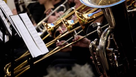 Close up shot of a baritone horn and several trumpets and trombone in the back...