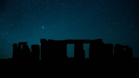 Stonehenge in Wiltshire, England, night time lapse of the stars