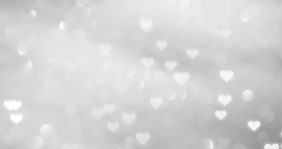 Magic white hearts flying slowly fall down on blurry silver bokeh reflection background.  | Shutterstock HD Video #34526707