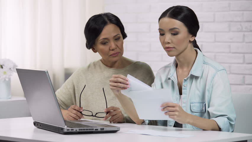 Family reading bill with big sum of money, unpleasant surprise, personal loan | Shutterstock HD Video #34533367
