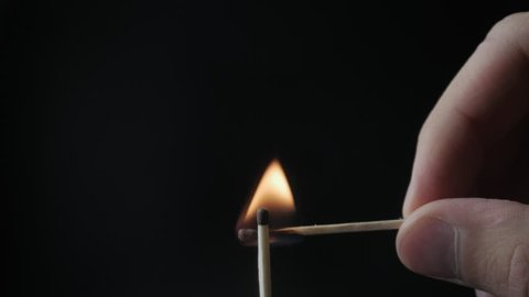 Burning Match And Flame. Safety Match close-up on a black background