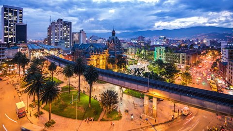 Medellin, Colombia, time lapse view of downtown buildings and Plaza Botero square at dusk.