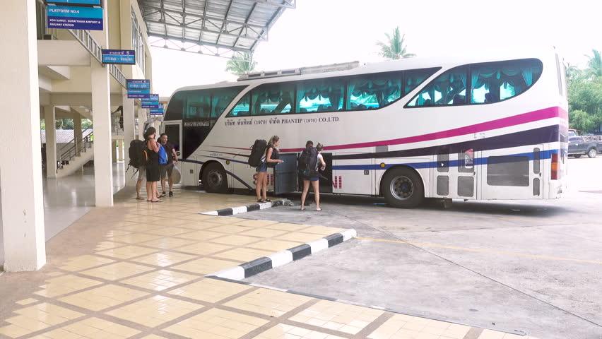 KOH SAMUI, THAILAND - December 20, 2017: Bus Terminal Samui. Tourists load luggage on the bus