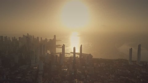 Beautiful aerial view of sunrise above Panama City, Panama (4K Drone)