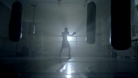 Man boxer training for a hard fight
