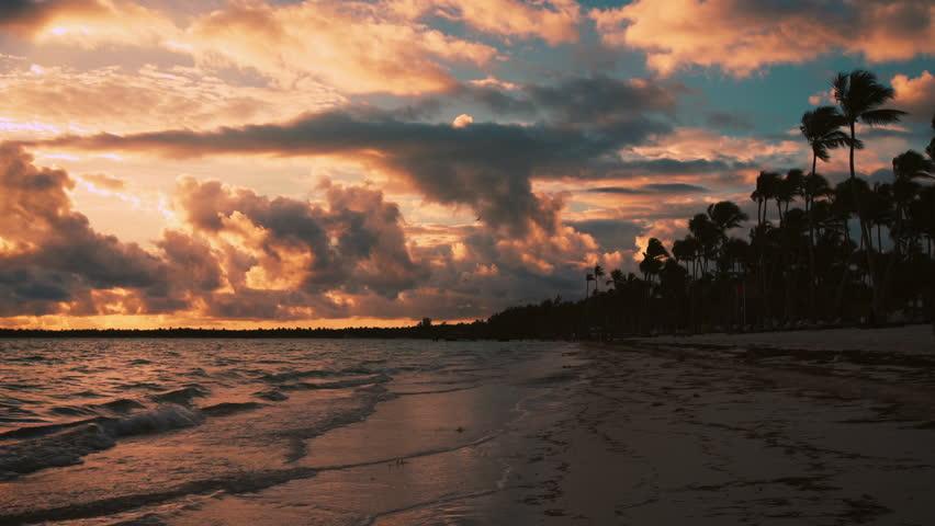 Sunrise sea view with cloudscape and tropical island beach. Punta Cana resort, Dominican Republic.