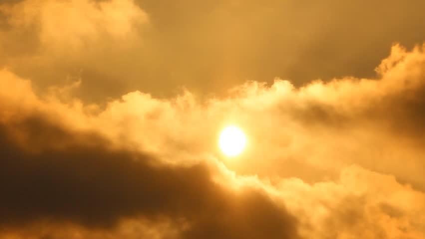Sun. Sunrise, sunset. Clouds, smoke.    Shutterstock HD Video #3471077