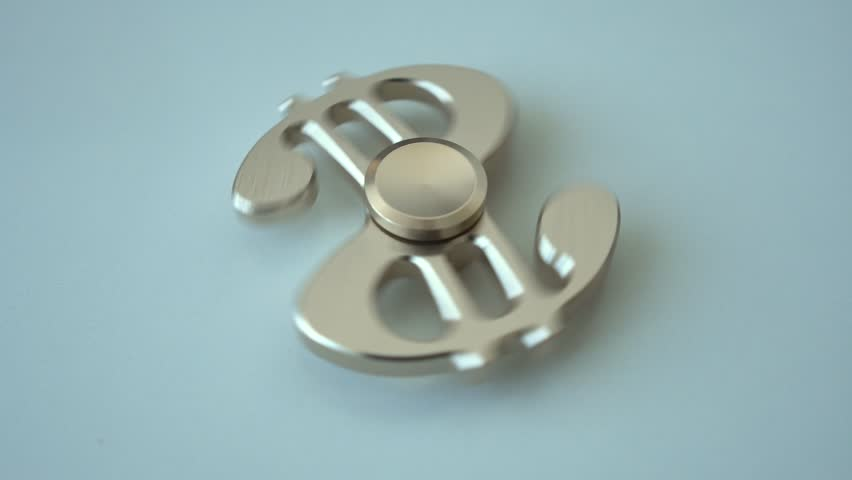 Rotation of the spinner in the form of a dollar on a light surface. Top View.4k | Shutterstock HD Video #34720807