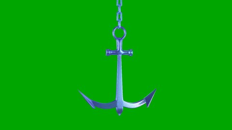 Rotating metal anchor, isolated on a green background.