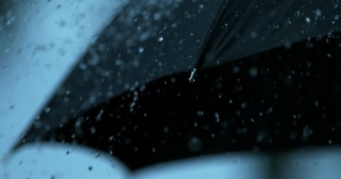 Rain slow motion dripping off black umbrella shot on Phantom Flex 4K