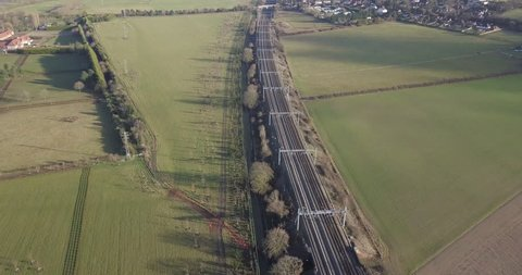 4k aerial footage fast high speed train on railway track beautiful countryside landscape in Berkshire, UK