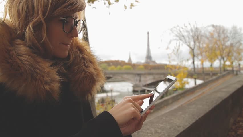 Cute young woman using mobile phone in Paris, France. | Shutterstock HD Video #34821619