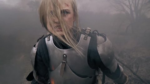 The furious Jeanne d Arc screams standing in the smoke, slow motion