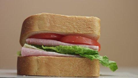 closeup of man's hand press the sandwich. finish movement to sandwich preparation