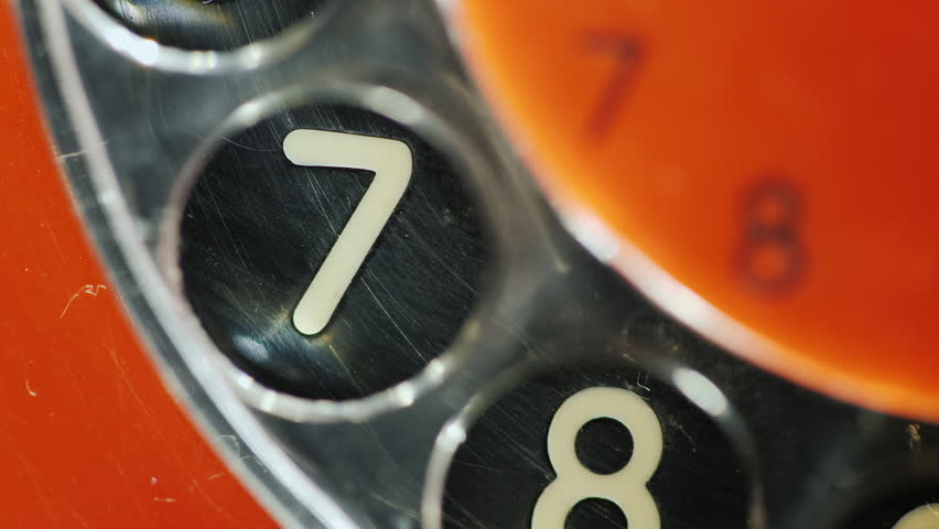 Dial the number on the old disk phone. Close-up, digit 7