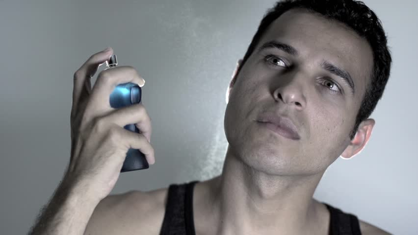 handsome man using perfume. fragrance fashion cosmetic. slow motion HD. male person people