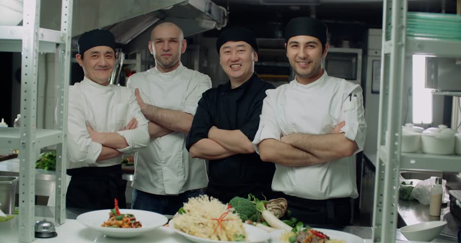 team of chefs Asian restaurant posing for the camera