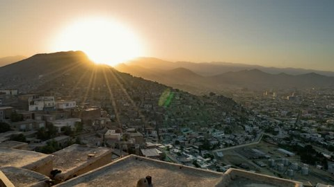 View of Kabul from high position. Time Lapse sunset. Residential area. Summer. Afghanistan