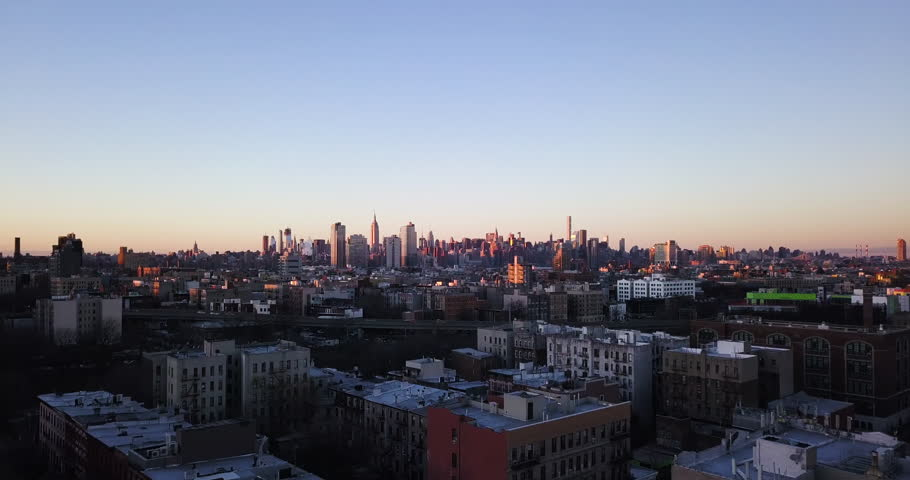 New York City Skyline buildings at dawn shot from aerial drone in 4k covering Brooklyn, Queens, and Manhattan   Shutterstock HD Video #34943092