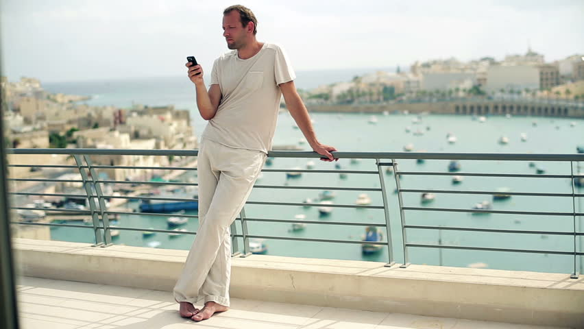 Young man using cellphone on the terrace