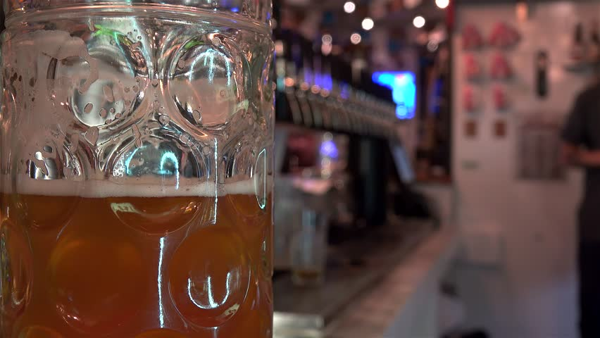 Beer mug on the pub counter. | Shutterstock HD Video #34963057
