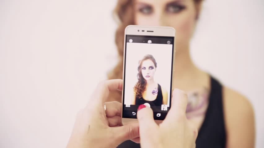 Someone takes a fashion model on a mobile phone camera | Shutterstock HD Video #35000974